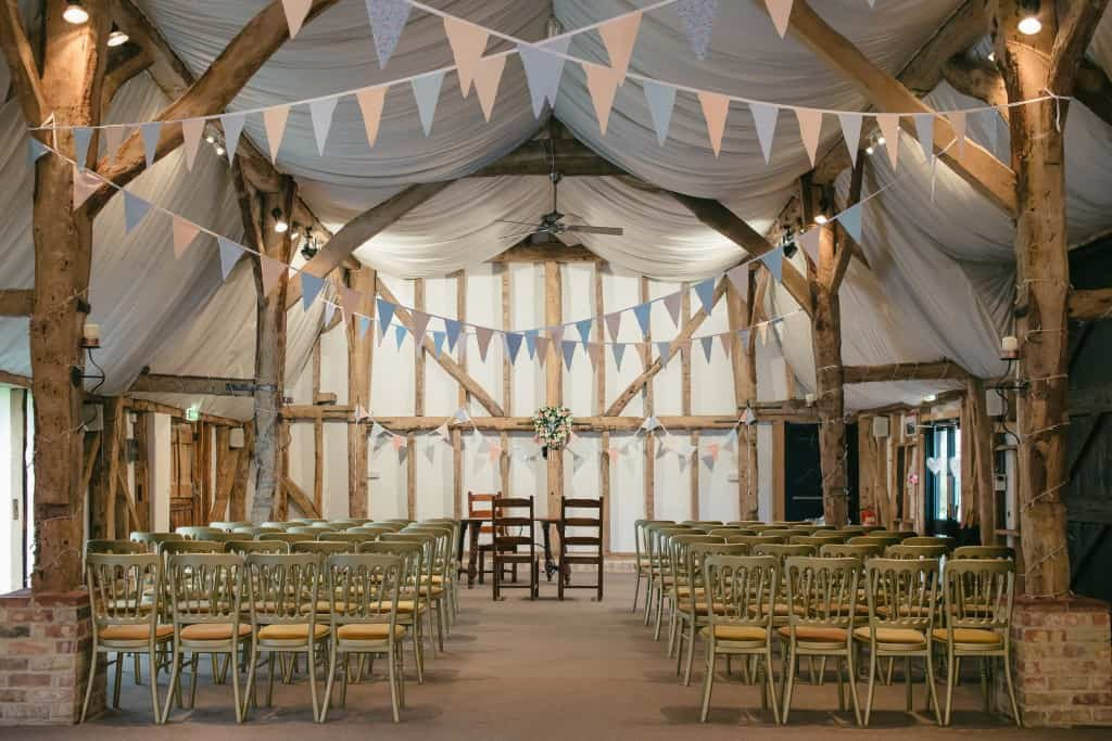 Tudor Barn Set for Ceremony with pretty bunting at South Farm