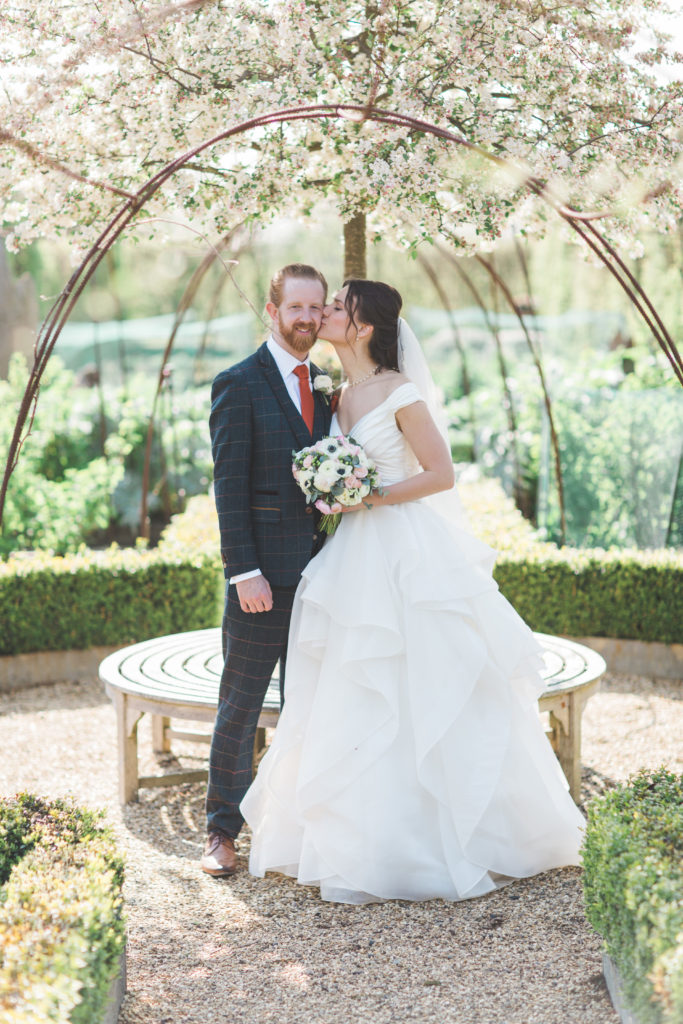 Couple in Wedding Garden under Blossom Tree at South Farm
