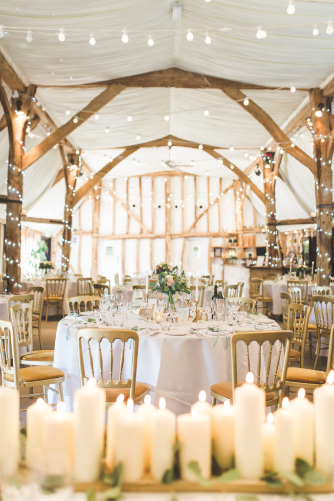 Tudor Barn at South Farm set for wedding meal with candles and looking pretty