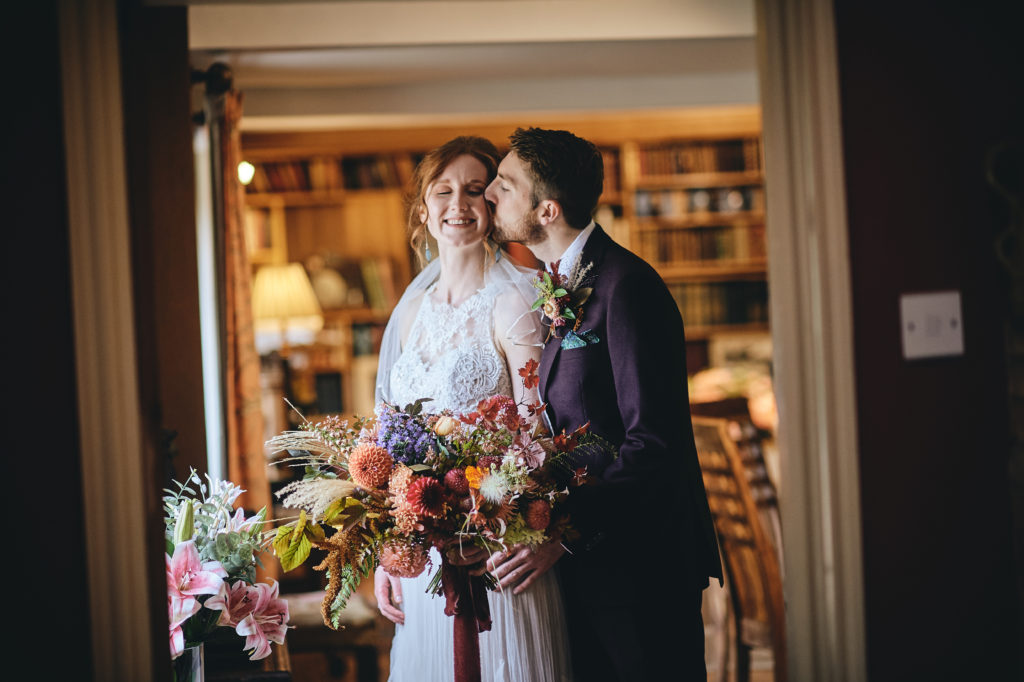 Bride and Groom share a moment at country house wedding venue